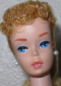 Number 7 Strawberry Blonde Ponytail Barbie showing her head shot